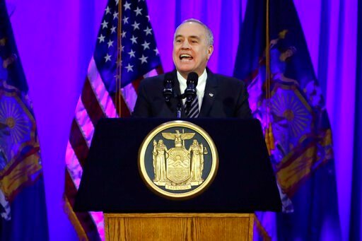 (AP Photo/Richard Drew, File). FILE - In this Jan. 1, 2019 file photo, New York State Comptroller Thomas DiNapoli delivers his address after taking his oath of office, on Ellis Island in New York harbor. New York's publicly funded Medicaid program paid...