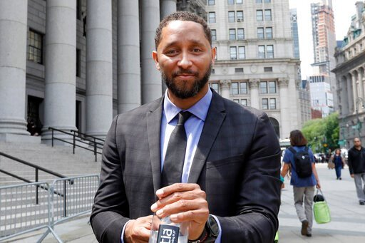 (AP Photo/Richard Drew). Former assistant basketball coach for the University of Southern California Tony Bland leaves federal court in New York, Wednesday, June 5, 2019. Bland was the first of four ex-coaches charged with crimes to plead guilty to bri...