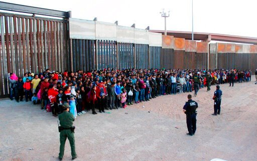 (U.S. Customs and Border Protection via AP, File). FILE - This May 29, 2019 file photo released by U.S. Customs and Border Protection (CBP) shows some of 1,036 migrants who crossed the U.S.-Mexico border in El Paso, Texas, the largest that the Border P...