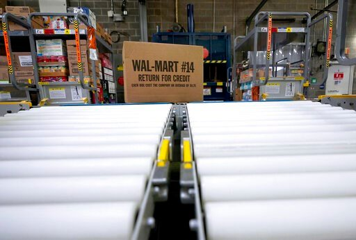 (AP Photo/David J. Phillip, File). FILE - In this Nov. 9, 2018, file photo, a box of merchandise is unloaded from a truck and sent along a conveyor belt at a Walmart Supercenter in Houston. Walmart is offering to have one of its employees deliver fresh...