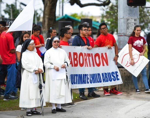 """(Frank San Nicolas/The Pacific Daily via AP). In this Jan. 22, 2017, photo, the Guam Catholic Pro-Life Committee holds its annual """"Chain for Life"""" protest against abortion at the Guam International Trade Center intersection in Tamuning, Guam. The first..."""