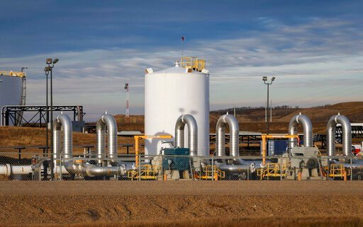 (Jeff McIntosh/The Canadian Press via AP, File). FILE - In this Nov. 6, 2015 file photo, a TransCanada's Keystone pipeline facility is seen in Hardisty, Alberta. A federal appeals court has lifted a judge's order Thursday, June 6, 2019, that blocked th...
