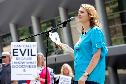 (AP Photo/Jeffrey McWhorter). FILE - In this Tuesday, June 12, 2018 file photo, rape survivor and abuse victim advocate Mary DeMuth speaks during a rally protesting the Southern Baptist Convention's treatment of women outside the convention's annual me...