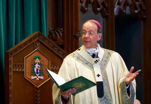 (AP Photo/Patrick Semansky, File). FILE - In this March 28, 2017, file photo, Baltimore Archbishop William Lori leads a funeral Mass in Baltimore. On Wednesday, June 5, 2019, Lori released a report on an investigation into former Roman Catholic Bishop ...