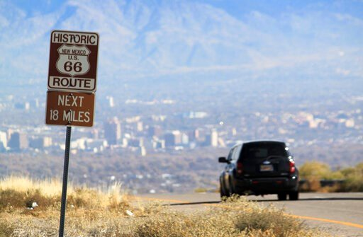 (AP Photo/Susan Montoya Bryan,File). FILE - In this Nov. 19, 2014 file photo a car travels down historic Route 66 toward Albuquerque, N.M. New Mexico's largest city is the latest to embark on upgrades to its portion of the historic Route 66 Highway.