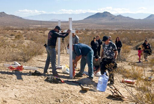 (James Quigg/The Daily Press via AP, File). FILE - In this Nov. 20, 2013, file photo, residents of Victorville, Calif., and surrounding communities place crosses near the graves where the McStay family was found in Victorville, Calif. A jury verdict wi...