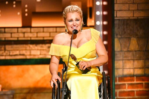 "(Photo by Charles Sykes/Invision/AP). Ali Stroker accepts the award for best performance by an actress in a featured role in a musical for ""Rodgers & Hammerstein's Oklahoma!""at the 73rd annual Tony Awards at Radio City Music Hall on Sunday, June 9,..."