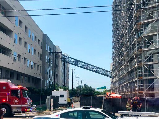 (Michael Santana via AP). This photo taken and provided by Michael Santana shows a construction crane toppling on an apartment building as it was buffeted by high winds during a storm in Dallas, Texas, Sunday, June 9, 2019.