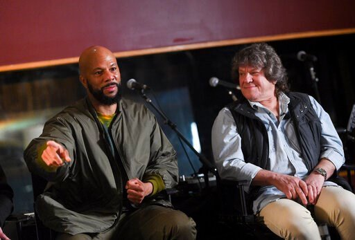 (Photo by Evan Agostini/Invision/AP, File). FILE - In a March 19, 2019 file photo, hip hop recording artist Common, left, and Woodstock co-producer and co-founder, Michael Lang, participate in the Woodstock 50 lineup announcement at Electric Lady Studi...