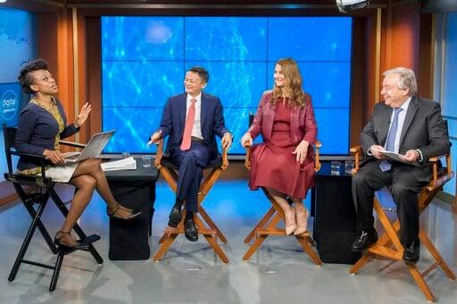 (Mark Garten/UN Photo via AP). Moderator Femi Oke, left, Jack Ma, second left, Melinda Gates, and United Nations Secretary-General Antonio Guterres, participate in a live conversation on digital cooperation, in a television studio at U.N. headquarters,...
