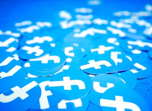 (AP Photo/Tony Avelar, File). FILE - In this April 30, 2019, file photo, Facebook stickers are laid out on a table at F8, Facebook's developer conference in San Jose, Calif. The Boston-based renewable energy developer Longroad Energy announced in May t...