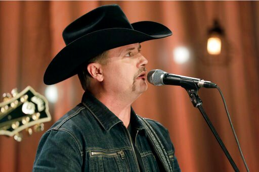 (AP Photo/Mark Humphrey, File). FILE - In a Dec. 13, 2016 file photo, John Rich of the country music duo Big & Rich performs a song during a taping for Dolly Parton's Smoky Mountain Rise Telethon in Nashville, Tenn. Fox News host Greg Gutfeld can n...