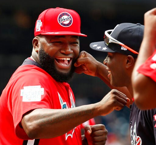 (AP Photo/Alex Brandon, File). FILE - In this July 15, 2018, file photo, World Team Manager David Ortiz (34) speaks with U.S. Team Manager Torrii Hunter, before the All-Star Futures baseball game at Nationals Park, in Washington. Ortiz returned to Bost...