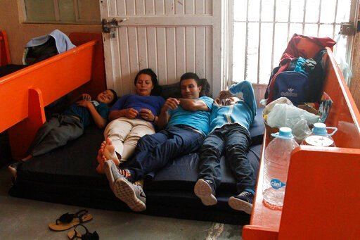 (AP Photo/Cedar Attanasio). In this June 10, 2019, photo, Mirna Esperanza Martinez, from El Salvador, rests with family members at the Buen Pastor migrant shelter in Ciudad Juarez, Mexico. They are subject to a new policy that makes asylum seekers wait...
