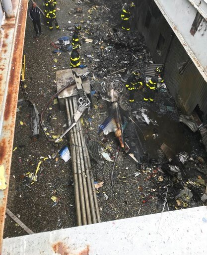 (FDNY via AP). This photo released by the New York City Fire Department shows damage caused by a helicopter crash, south of Central Park in New York on Monday, June 10, 2019. The crash that killed the pilot and occurred near Times Square and Trump Towe...