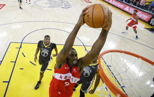 (AP Photo/Tony Avelar, Pool). Toronto Raptors center Serge Ibaka (9) dunks against the Golden State Warriors during the second half of Game 4 of basketball's NBA Finals in Oakland, Calif., Friday, June 7, 2019.