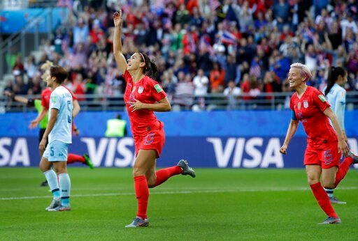 (AP Photo/Alessandra Tarantino). United States' Alex Morgan, left, celebrates after scoring the opening goal during the Women's World Cup Group F soccer match between United States and Thailand at the Stade Auguste-Delaune in Reims, France, Tuesday, Ju...