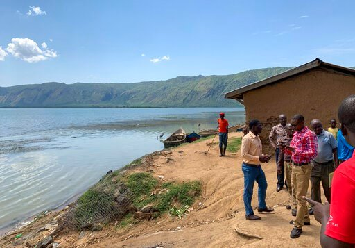 (Ben Wise/International Rescue Committee via AP). This photo taken Thursday, April 18, 2019 and released by the International Rescue Committee (IRC), shows the shores of Lake Albert near the border with Congo, at Kabakanga in Kagadi district, western U...