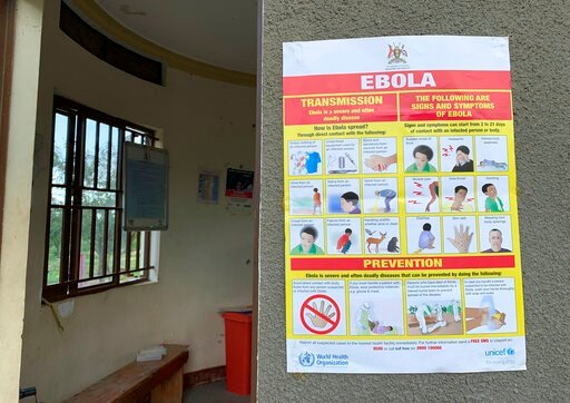 (Ben Wise/International Rescue Committee via AP). This photo taken Thursday, April 18, 2019 and released by the International Rescue Committee (IRC), shows an Ebola-prevention information sign at the Ndaiga Health Centre II, near the shores of Lake Alb...