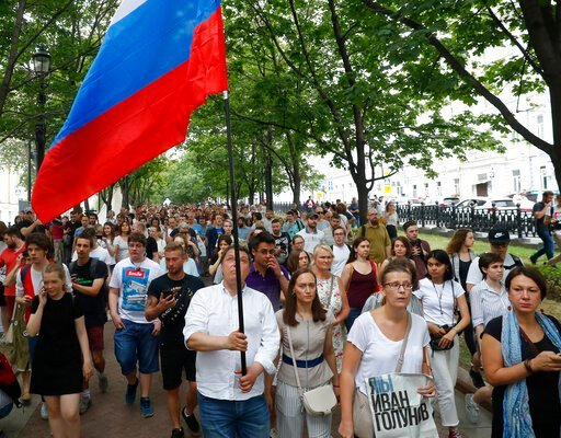 (AP Photo/Pavel Golovkin). Supporters of Russian investigative journalist Ivan Golunov and other protesters gather to attend a march in Moscow, Russia, Wednesday, June 12, 2019.