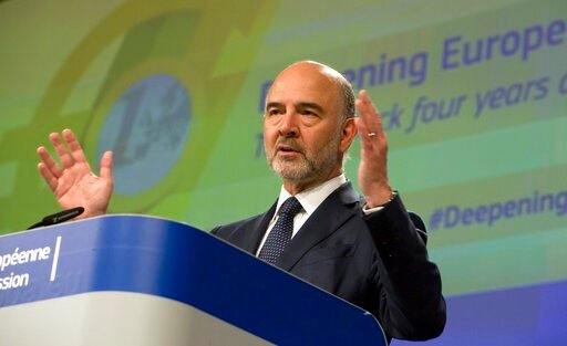 (AP Photo/Virginia Mayo). European Commissioner for Economic and Financial Affairs Pierre Moscovici speaks during a media conference at EU headquarters in Brussels, Wednesday, June 12, 2019. The European Commission on Wednesday took stock of the progre...