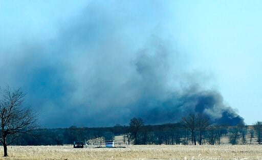 (Kevin Harvison/The McAlester News-Capital via AP, File). FILE - In this Monday, Jan. 22, 2018, file photo, smoke billows from the site of a gas well fire near Quinton, Okla. A federal report says the explosion and fire that killed five workers at the ...