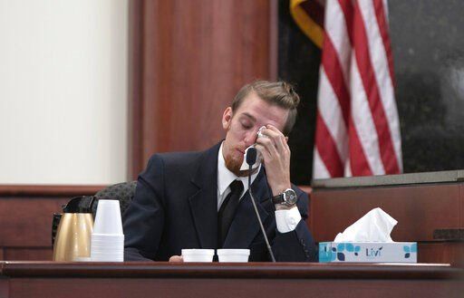 (Tracy Glantz/The State via AP, Pool). Tyler Jones wipes his eyes while testifying during the sentencing phase of the trial of his half brother, Tim Jones in Lexington, S.C., Wednesday, June 12, 2019. Timothy Jones, Jr. was found guilty of killing his ...