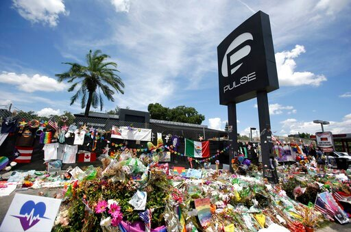 (AP Photo/John Raoux, File). FILE - In this July 11, 2016, file photo, a makeshift memorial continues to grow outside the Pulse nightclub in Orlando, the day before the one month anniversary of a mass shooting, in Orlando, Fla. Floridians and others ar...
