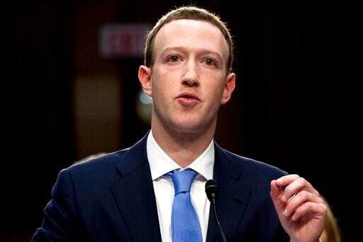 (AP Photo/Andrew Harnik, File). FILE - In this April 10, 2018, file photo, Facebook CEO Mark Zuckerberg testifies before a joint hearing of the Commerce and Judiciary Committees on Capitol Hill in Washington. Weeks after Facebook refused to remove a do...