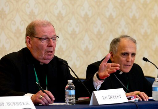 (AP Photo/Jose Luis Magana). Robert Deeley, left, Bishop of the Diocese of Portland, accompanied by Cardinal Daniel DiNardo, of the Archdiocese of Galveston-Houston and President of the United States Conference of Catholic Bishops (USCCB), speaks durin...