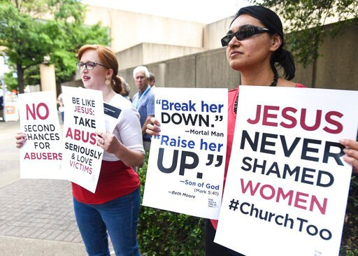 (AP Photo/Julie Bennett). Jennifer Weed, left, and Nisha Virani, both of Birmingham, Ala., demonstrate outside Southern Baptist Convention's annual meeting Tuesday, June 11, 2019, during a rally in Birmingham, Ala. The For Such A Time As This protest c...