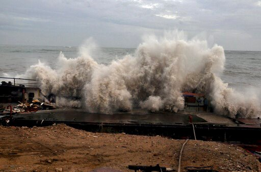 (AP Photo). A waves crashes on the Arabian Sea coast in Porbandar, Gujarat, India, Wednesday, June 12, 2019. Indian authorities evacuated tens of thousands of people on Wednesday as a severe cyclone in the Arabian Sea approached the western state of Gu...