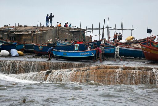 (AP Photo/Ajit Solanki). People move a fishing boat to a safer ground on the Arabian Sea coast in Veraval, Gujarat, India, Wednesday, June 12, 2019. Indian authorities evacuated tens of thousands of people on Wednesday as a severe cyclone in the Arabia...