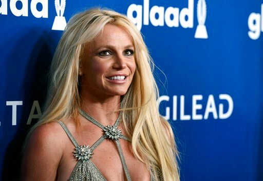(Photo by Chris Pizzello/Invision/AP, File). FILE - This April 12, 2018, file photo shows Britney Spears at the 29th annual GLAAD Media Awards in Beverly Hills, Calif. A Los Angeles judge is set to consider whether to extend a temporary restraining ord...