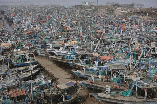 (AP Photo/Fareed Khan). Pakistani fishermen boats are called back from the sea following a warning by authorities of Cyclone Vayu at Karachi harbor in Pakistan, Thursday, June 13, 2019. The meteorological department Thursday issued an alert, warning fi...