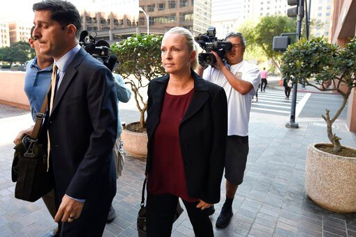 (AP Photo/Denis Poroy). FILE - In this Thursday, Aug. 23, 2018 file photo, Margaret Hunter, center, the wife of U.S. Rep. Duncan Hunter, arrives for an arraignment hearing in San Diego. Rep. Duncan Hunter's wife is planning to change her not-guilty ple...