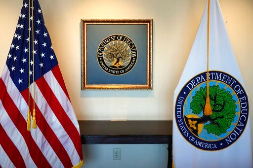 (AP Photo/Jacquelyn Martin). In this Aug. 9, 2017, photo, flags decorate a space outside the office of Education Secretary Betsy DeVos, at the Education Department in Washington. The U.S. Education Department is warning America's universities that they...