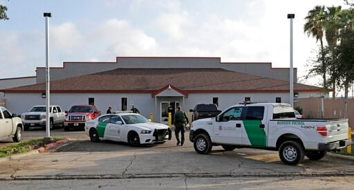 (AP Photo/David J. Phillip, File). FILE - In this Saturday, June 23, 2018, file photo, a U.S. Border Patrol Agent walks between vehicles outside the Central Processing Center in McAllen, Texas. Advocates were shocked to find an underage mom and her tin...