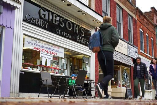 (AP Photo/Dake Kang, File). FILE - In this Nov. 22, 2017 file photo, pedestrians pass the storefront of Gibson's Food Mart & Bakery in Oberlin, Ohio. A jury has awarded $11 million to a father and son who claimed Ohio's Oberlin College and an admin...