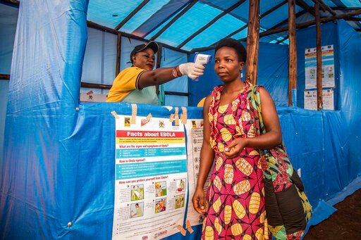 (Kellie Ryan/International Rescue Committee via AP). In this photo provided by the International Rescue Committee, a Congolese refugee is screened for Ebola symptoms at the IRC triage facility in the Kyaka II refugee settlement in Kyegegwa District in ...