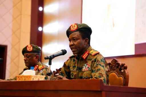 (AP Photo). Sudan's ruling Military Council spokesperson Shamseddine Kabbashi makes a speech as he holds a press conference at the Presidential Palace in Khartoum, Sudan, Thursday, June 13, 2019.
