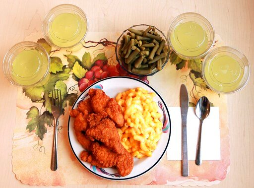 """(Paule Joseph, Shavonne Pocock/NIH via AP). This undated photo provided by the National Institutes of Health in June 2019 shows an """"ultra-processed"""" lunch including brand name macaroni and cheese, chicken tenders, canned green beans and diet lemonade. ..."""