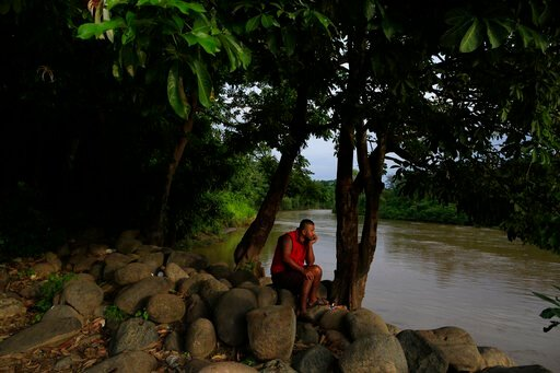 (AP Photo/Rebecca Blackwell). A local resident relaxes beside the Suchiate river in Frontera Hidalgo, Mexico, on the border with Guatemala, Thursday, June 13, 2019. Mexico announced recently that it's sending National Guard agents to its southern regio...