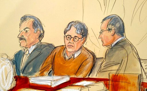 (Elizabeth Williams via AP, File). FILE - In this Tuesday, May 7, 2019 file courtroom drawing, defendant Keith Raniere, center, leader of the secretive group NXIVM, is seated between his attorneys Paul DerOhannesian, left, and Marc Agnifilo during the ...