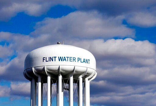 (AP Photo/Carlos Osorio, File). FILE - In this March 21, 2016 file photo, the Flint Water Plant water tower is seen in Flint, Mich. Prosecutors dropped all criminal charges Thursday, June 13, 2019, against eight people in the Flint water scandal and pl...