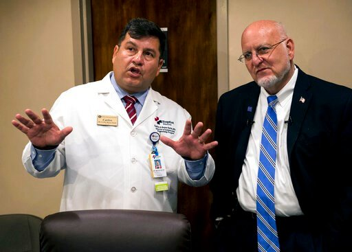 (Jake Crandall/Montgomery Advertiser via AP). Dr. Carlos Reyes-Sacin, left, shows CDC director Robert Redfield inside a telemedicine room at the Medical Advocacy and Outreach clinic in Montgomery, Ala. on Friday, June 14, 2019.