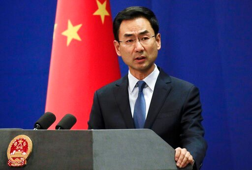 (AP Photo/Andy Wong, FILE). FILE - In this file photo dated Tuesday, Jan. 29, 2019, Chinese Foreign Ministry spokesman Geng Shuang speaks during a daily briefing at the Ministry of Foreign Affairs office in Beijing.  Foreign ministry spokesman Geng Shu...