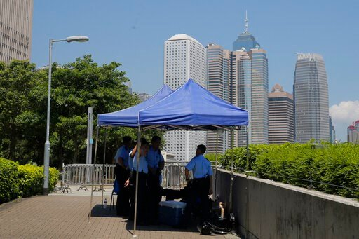 (AP Photo/Kin Cheung). Police officers watch over an area near the Legislative Council, in Hong Kong, Saturday, June 15, 2019. Pressure on Hong Kong's Chief Executive Carrie Lam was mounting Saturday, with signs emerging that she may delay an unpopular...