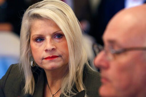 (AP Photo/Danny Johnston, File). FILE - In this Wednesday, Jan. 28, 2015, file photo, Sen. Linda Collins-Smith, R-Pocahontas, listens to testimony at a meeting of the Senate Committee on Public Health, Welfare and Labor at the Arkansas state Capitol in...