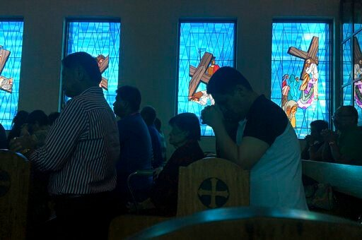 (AP Photo/Tassanee Vejpongsa, File). FILE - In this Aug. 13, 2017, file photo, worshippers attend Sunday Mass at Blessed Diego de San Vitores Church in Tumon, Guam. No doctors are willing to perform abortions in the U.S. territory of Guam, and the isla...